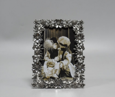 Фоторамка цветочная из олова