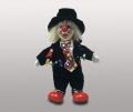 Кукла клоун в черной шляпе
