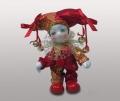 Клоун кукла в красном колпаке с бубенчиками