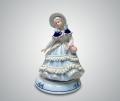 Музыкальная статуэтка девушка в шляпке с авоськой