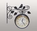 Часы на кронштейне из металла с птицей