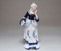 Статуэтка декоративная дама с корзинкой